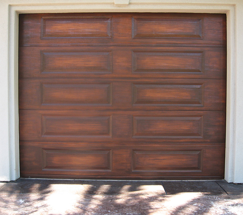 Garage doors more showcase beams for Faux wood doors